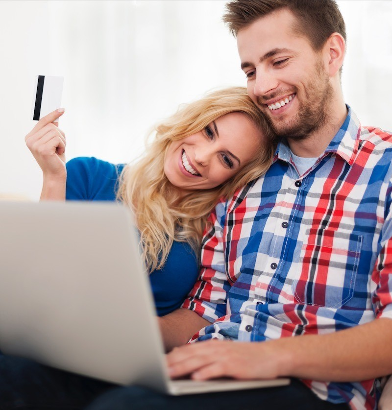 Young couple paying property inventory by card